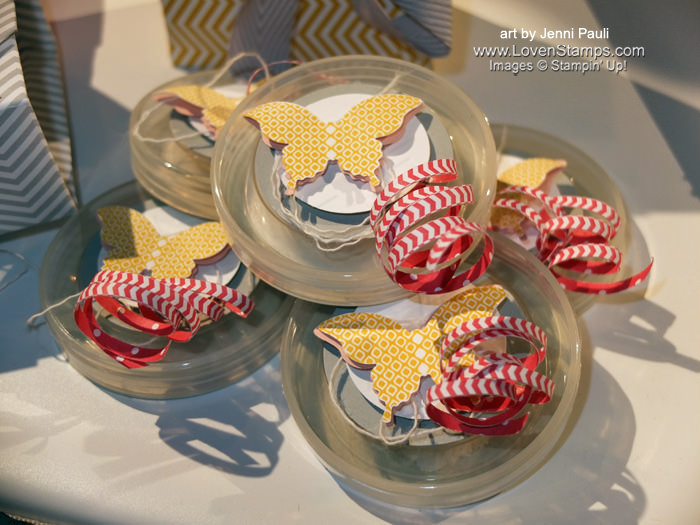 Shared at Convention 2013: Elegant Butterfly Favor Boxes! Punch card stock circles to cover up the labels & embellish.